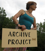 "woman holding ""Archive Project"" sign"